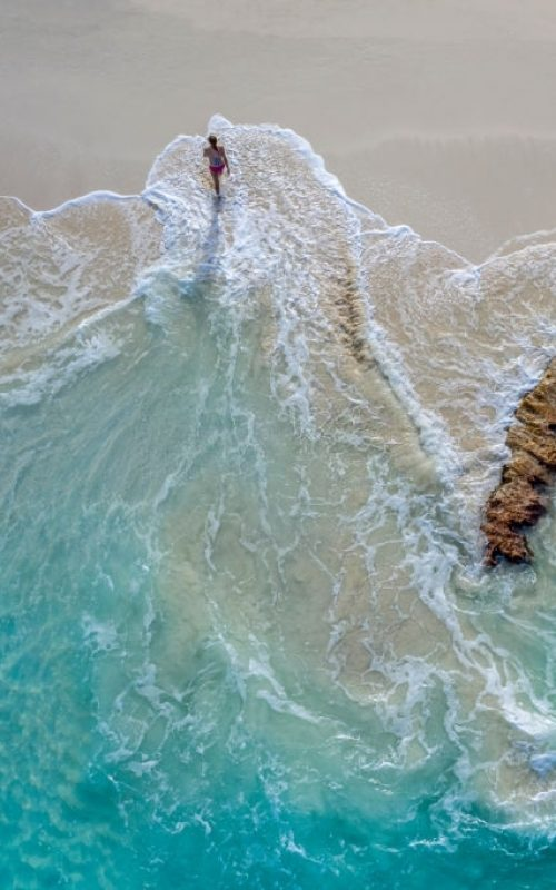 Aerial view of a woman walking out of the water_Little Exuma_Exuma_Bahamas